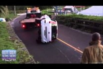 Overturned Car Removed By Tow Truck
