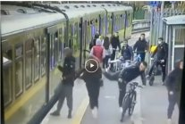 r/ireland - new longer version of the DART scumbags pushing a woman