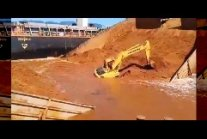 Barge Sinks With Excavator